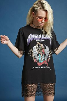 "A T-shirt dress featuring a front ""American Tour 1997 Romantic Revolution"" with a guitar image, a back ""Romantic Revolution"" with cities listed, a sheer eyelash lace hem, crew neck, and short sleeves with sheer eyelash lace trim."