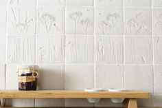 We love this splashback created with our bespoke Cotes Meadow and Plain handmade tiles.