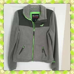 SALE   HOLLISTER Fleece Zip Jacket Hollister gray fleece jacket, with neon green zippers.  Two zip pockets in front.  In great condition!! Hollister Jackets & Coats