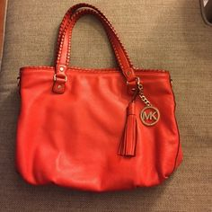 Michael kors purse!!!! This is a red leather purse with gold hardware. One pocket on the outside with five pockets on the inside, one of which zips. The lining had several very small stains from being well loved. This bag is in excellent condition!!!!! MICHAEL Michael Kors Bags