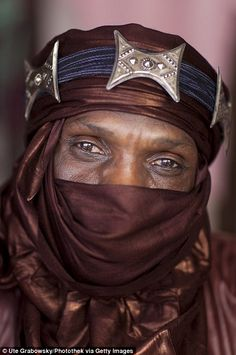A portrait of a Tuareg Man wearing a fanciful turban in Niamey, Niger. The Tuareg are a Berber people with a traditionally nomadic pastoralist lifestyle