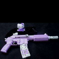 Okay- I'm not a gun person, but nothing says 'bad ass' more than a Hello kitty gun.   These will be my zombie apocalypse weapons.