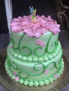 Tinker Bell Cake  Quite like this, but with a different flower on top!