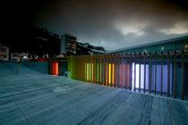 Even the public toilets look good in Oriental Bay, Wellington, New Zealand! The timber wall filters the coloured neon lights at night, which are activated when the WC is in use.