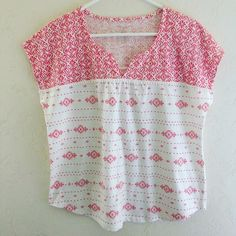 Aztec Bohemian Print Tee EUC like new Aztec bohemian print tee. Has a really cute tiny Pom Pom fringe. This is a petite so it is shorter in length. Size Petite L. 60% cotton 40% polyester. Offers welcome. Sonoma Tops Tees - Short Sleeve