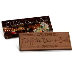 """Your custom wrapper bar will be unique, colorful and eye catching! Each custom designed Belgian milk or dark chocolate bar has a gold foil inner wrap and then is enclosed in your one-of-a-kind custom wrapper. Great for product launch, employee recognition, corporate event or wedding. Includes your custom engraved design on the chocolate and your full color artwork on all sides of the wrapper for maximum exposure! 2"""" x 5"""" x 3/16""""."""