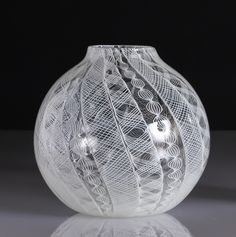 """Laced Glass Rose Bowl by Frost Glass. Durable enough to be used as a storage or serving piece, but beautiful enough to stand on its own as a centerpiece! Each beautiful bowl is composed of a delicate white glass decoration called """"filigree"""". This pattern is created by interweaving and layering of individual glass cane."""