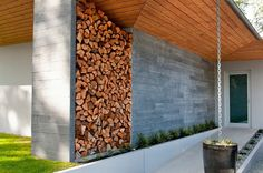 Stacked firewood gives this entry a dramatic makeover
