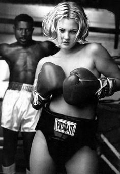 Drew Barrymore. In highschool I bought Everlast work out wear just because of this picture (which was on my wall).