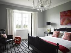 dado rail grey walls patterned carpet red accents bedroom