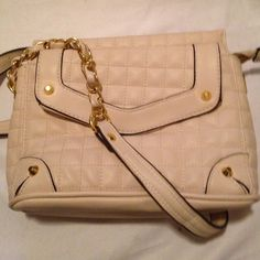 NWOT JESSICA SIMPSON CARLYLE CROSSBODY This beautiful quilted cross body has a single chain accent shoulder strap with zip top closure. The exterior features front flap pocket with magnetic closure, back zip wall pocket, and quilted construction. The interior features zip wall pocket and two media pockets. dimensions 7 x 9 x 3.5 with a 23 inch strap drop. Mint!!!!! Jessica Simpson Bags Crossbody Bags