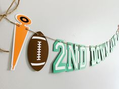 Football birthday party decorations designed and crafted by Declan & Smith Party Décor. #footballdecorations #footballbirthdayparty Baseball First Birthday, Football Birthday, Sports Birthday, Baseball Party Decorations, First Birthday Party Decorations, Football Phrases, Football Baby Shower, Baseball Banner, Fall Birthday Parties
