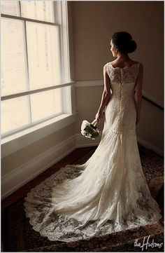 one of the most beautiful wedding gowns I've seen. Ladies, can we say good-bye to strapless wedding gowns, please? this is so feminine and appropriate for a church.