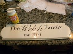 Family Plaque uses tissue paper and Mod Podge to add wording to wood