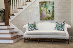 Underwood Interiors - entrances/foyers - chic foyer, abstract art, camelback sofa, white camelback sofa, foyer sofa, suzani pillows, blue and green suzani pillow,