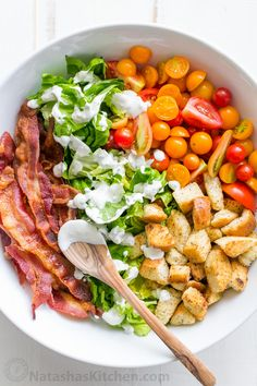 BLT Salad loaded with fresh lettuce, crispy bacon, bright tomatoes ...