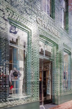 "Crystal Houses Amsterdam by MVRDV.  Replaces Chanel store's traditional facade with glass bricks that are ""stronger than concrete"". Uses glass bricks, windows frames and architraves to recreate the city's traditional architectural style."