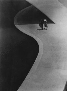 A Couple Walking in the Shadow of the Trylon, New York World's Fair, 1939. Photo by Stanley Rayfield.