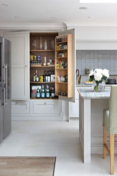 Stand Alone Pantry Cabinets Transitional Style for Kitchen with Gray Tile Backsplash by Brayer Design in London