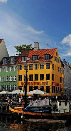 Nyhavn Harbor, Copenhagen, Denmark, Europe - It really doesn't get hot in summer, so its one of the places to be, sitting outside, drinking a nice cup of tea...