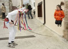 A man dressed as a momotxorro mythological character tries to hit a girl taking part in the ancient carnival of Unanu in the north of Navarra province in Spain on March 8. Momotxorros chase locals and hit them with sticks. (Rafa Rivas/AFP/Getty Images)
