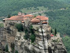 Meteora, Greece. Monks built it and still live in it. It is fascinating.