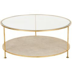 Andrew+Martin+Genevieve+Coffee+Table+-+Glass+top+coffee+table+with+shagreen+base+from+Andrew+Martin. The+Genevieve+Coffee+Table+has+a+circular+frame+and+channels+timeless+and+luxurious+appeal. The+table+comes+with+a+lavish+gold+frame+while+the+bottom+shelf+is+adorned+in+a+faux+shagreen+finish. The+gorgeous+furniture+piece+is+finished+with+a+glass+table+top. The+impressive+table+will+add+unique+designer+style+to+your+to+your+lounge+or+living+area.