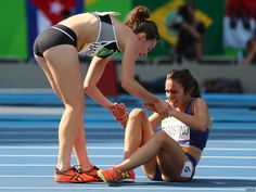 Abbey D'Agostino of the United States is assisted by Nikki Hamblin of New Zealand after a collision during the Women's Round 1 - Heat 2 on Day 11 of the Rio 2016 Olympic Games at the Olympic. Get premium, high resolution news photos at Getty Images Us Olympics, Rio Olympics 2016, Summer Olympics, Olympic Medals, Olympic Games, Olympic Runners, The Rival, Olympic Champion, Faith In Humanity