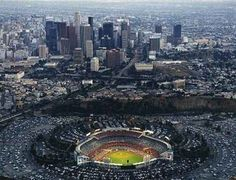 Dodgers Stadium and the great city of Los Angeles. Dodger Game, Dodger Stadium, Baseball Park, Dodgers Baseball, Baseball Stuff, Football, Places Around The World, Around The Worlds, Mlb Stadiums