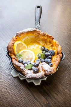 Dutch Baby with lemon curd and blueberries.