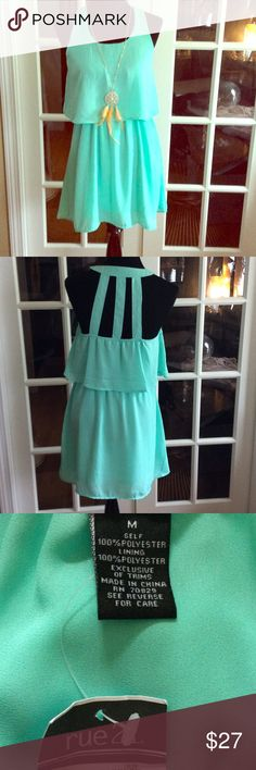 Aqua Summer Dress sz M Cute dress feels like chiffon its lined and 100% Polyester. It has elastic waist and back has half elastic on back side. Shown with Dream catcher Necklace also for sale in my closet. Rue 21 Dresses