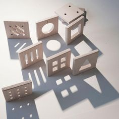 Shapes wooden puzzle. Shapes Depth Shadows. Educational toy.