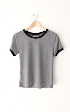 "- Description Details: Soft & short sleeve ringer tee with all over horizontal stripes in black/white and black contrast collar & sleeve bands. Relaxed fit. Measurements: (Size Guide) S: 33"" bust, 22."