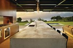 When the walls are raised, the house feels more like an open-air pavilion--with direct sightlines to the water. Ad Mexico, Interior Architecture, Interior And Exterior, Interior Design, Cookie Cutter House, Beach Mansion, Dream Beach Houses, Stylish Kitchen, Indoor Outdoor Living