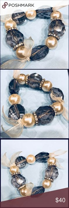 """Faux pearl boho chic bracelet Boho chic style bracelet. Faux pearl and large, clear, crystal balls, has a small ring of """"diamonds"""" and small ribbon tied around bracelet. Lots of pictures taken to show all details of bracelet. The pearls are white. The do not have a yellow tone to them. Gorgeous, but not my style. The bracelet is stretchy. Jewelry Bracelets"""