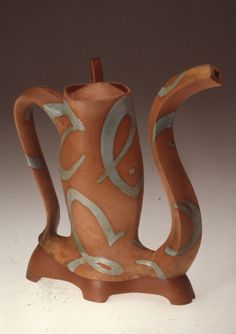 James Lawton   Orange teapot with script