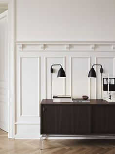 Love that wood work on the wall. The millwork has a traditional feel mixed with a sleek, modern console.