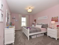 White furniture looks great in this pink little girl's room. Seen in the Grandin at Reserve at Pickerington Ponds located in Pickerington, Ohio. | Fischer Homes