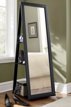 Black Full Length mirror that has a 360 spin swivel feature. The backside has shelves for storage!
