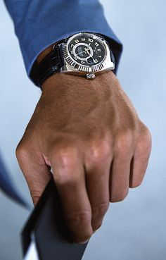 Professional golfer Adam Scott, wearing a Rolex Sky-Dweller in 18 ct white gold with a luxurious black leather strap.