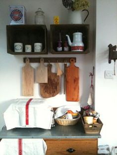 Kitchen wall cutting boards of multiple woods hanging
