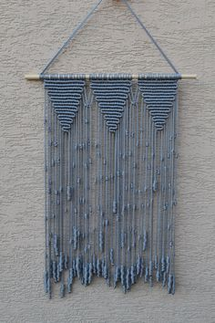 Wall panels handmade macramé technique. Material: 100% polyester. Color: light gray. Strap: natural wood - pine. Dimensions: The length of the strap to the bottom, including the thread - 64cm / 25,2 inches Width - 38cm / 15 inches