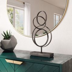 Tangled circles of varying sizes mingle together in this abstract sculpture for the tabletop or shelf. The distressed gray finish of the metal piece gives it character for a modern or industrial space. A heavy metal base keeps the sculpture standing no matter where you use it. Sculpture Stand, Hand Sculpture, Abstract Sculpture, Tall Vase Decor, Vases Decor, Decorative Objects, Decorative Pillows, Agate Decor, Sculptures For Sale