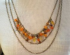 Tangerine Tango Triple Chain Necklace | This is a super gorgeous layered necklace that is perfect for that fall!
