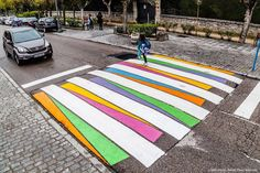 Madrid's Crosswalks Turned into Colorful Artworks   Bulgarian artist Christo Guelov turned crosswalks in Madrid into colorful street art artworks to give more gaiety to the tarmac. He uses geometrical shapes and colors and offers creations that call to borrow the crosswalks and crossing the street in security.