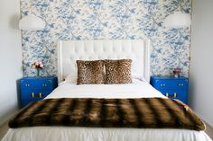 White bed with Cheetah print pillows