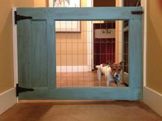 Made my own dog gate using half an old door with the glass traded for fencing! Laundry Room, Laundry, Laundry Rooms