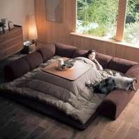 This Japanese Invention Is The Perfect Excuse To Never Get Out Of Bed This Winter Metal Wall Decor, Metal Wall Art, Japanese Inventions, Floor Couch, Roman Clock, Warm Bed, Metal Clock, Getting Out Of Bed, Beautiful Wall