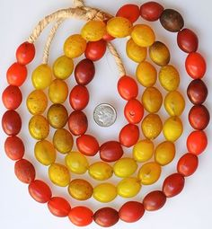 Trade Beads |  Matched Bohemian egg Beads, available in red or yellow | Date: Early 1900s