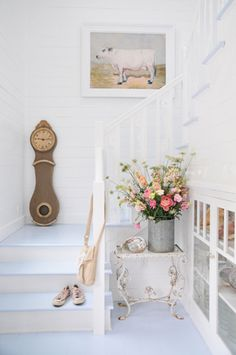 Mora clock, white stairway, flowers, cow pic